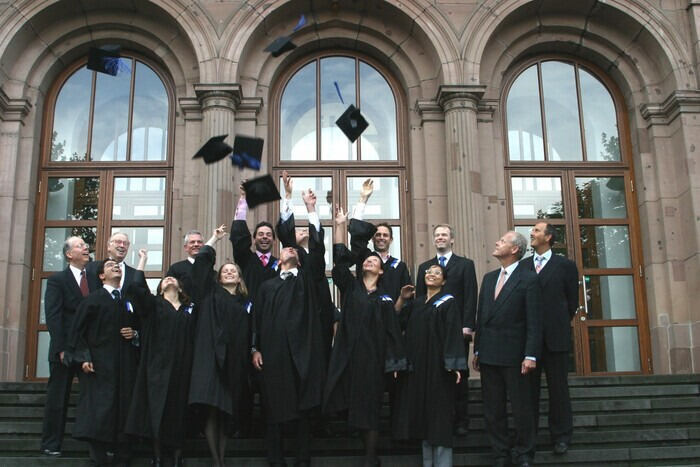 Graduates in front of the main building