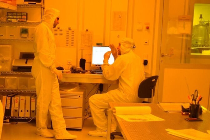 graduate and undergraduate student in clean room